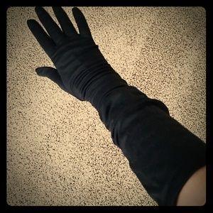 Elbow length dress gloves.